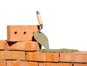red bricks and masonry trowel